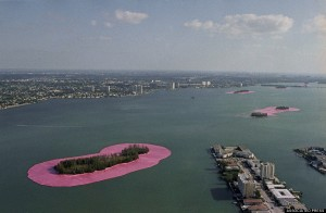 """Christo's """"Surrounded Islands"""" take on the appearance of giant Lilly pads as the 3.1 million dollar art project in Biscayne Bay in Miami, May 7, 1983. The skyline of downtown Miami is in the background. (AP Photo/Pete Wright)"""