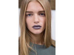 Acne: Bold, groomed brows and grey lipstick were the highlights of the makeup looks.